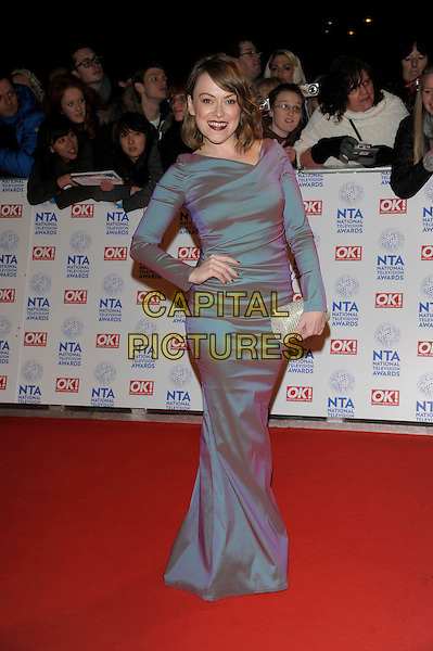 Sian Reese-Williams.National Television Awards at the 02 Arena, London, England..January 23rd, 2013.NTA NTAs full length dress blue hand on hip silver clutch bag .CAP/PL.©Phil Loftus/Capital Pictures.
