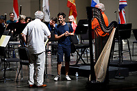 Valerio Lisci from Italy shares a laugh with conductor Arthur Fagen after an orchestra rehearsal for the Final Stage concert at the 11th USA International Harp Competition at Indiana University in Bloomington, Indiana on Friday, July 12, 2019. (Photo by James Brosher)