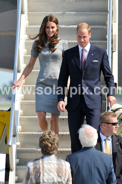 **ALL ROUND PICTURES FROM SOLARPIX.COM**                                             **WORLDWIDE SYNDICATION RIGHTS**                                                                                  The Duke and Duchess of Cambridge arrive at Montreal Airport during the Royal Tour of Canada. Prince William and Catherine are greeted as they leave the plane,                                                                    This pic:   Prince William and Catherine, Duchess of Cambridge                                                                                           JOB REF:   13665     MSR       DATE:  04.07.11                                                          **MUST CREDIT SOLARPIX.COM OR DOUBLE FEE WILL BE CHARGED**                                                                      **MUST AGREE FEE BEFORE ONLINE USAGE**                               **CALL US ON: +34 952 811 768 or LOW RATE FROM UK 0844 617 7637**