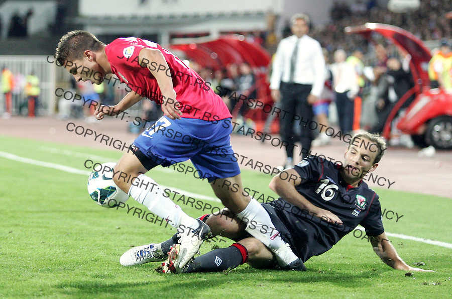 NOVI SAD, SERBIA - SEPTEMBER 11: Aleksandar Ignjovski (L) of Serbia is challenged by David Vaughan (R) of Wales during the FIFA 2014 World Cup Qualifier at stadium Karadjordje Park between Serbia and Wales on September 11, 2012 in Novi Sad, Serbia (Photo by Srdjan Stevanovic//Getty Images)