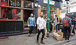 pic shows: Brick Lane - Exterior of Cereal Killer daubed in paint and graffiti  - Gary and Alan Keely twin brothers leaving the cafe today said they did not want to talk about the incident. Their cafe was still packed.<br /> <br /> Gary Keely, who founded Cereal Killer Cafe with his twin brother Alan, are  selling bowls for &pound;3.20 in one of the most deprived areas of London.<br /> <br /> <br /> <br /> <br /> <br /> &quot;Anti Gentrification&quot; protest in Shoreditch area which attack small businesses including cafe selling cereal &quot;Cereal Killer&quot; and an estate agents<br /> <br /> <br /> <br /> <br /> <br /> picture by Gavin Rodgers/ Pixel