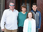 Faye Christie from LeCheile school who was confirmed in St Mary's church pictured with dad David, mam Sandra and brother Matthew. Photo:Colin Bell/pressphotos.ie