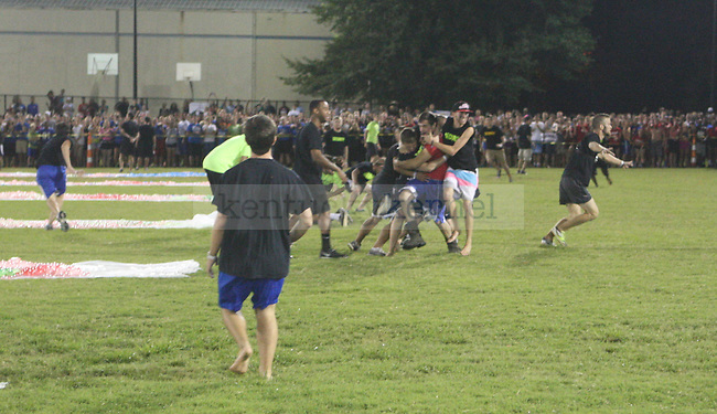 Participants are tackled by CSF security as they enter the water balloon area prior to the beginning of the water balloon fight. The University of Kentucky police department entered the field after the first few people ran inside in Lexington , Ky., on Friday, September 6, 2013. Photo by Eleanor Hasken | Staff