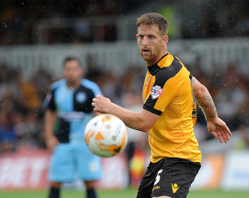 Newport County's Darren Jones in action during todays match  <br /> <br /> Photographer Ashley Crowden/CameraSport<br /> <br /> Football - The Football League Sky Bet League Two - Newport County AFC v Wycombe Wanderers - Saturday 9th August 2014 - Rodney Parade - Newport<br /> <br /> &copy; CameraSport - 43 Linden Ave. Countesthorpe. Leicester. England. LE8 5PG - Tel: +44 (0) 116 277 4147 - admin@camerasport.com - www.camerasport.com