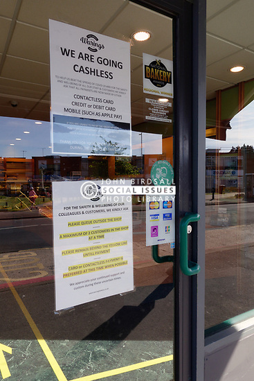 Coronavirus warning sign on bakery door during Coronavirus lockdown, Reading UK May 2020