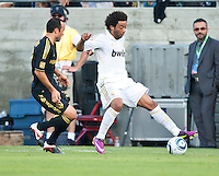 LOS ANGELES, CA – July 16, 2011: Landon Donovan (10) of the LA Galaxy and Marcelo (12) of Real Madrid during the match between LA Galaxy and Real Madrid at the Los Angeles Memorial Coliseum in Los Angeles, California. Final score Real Madrid 4, LA Galaxy 1.