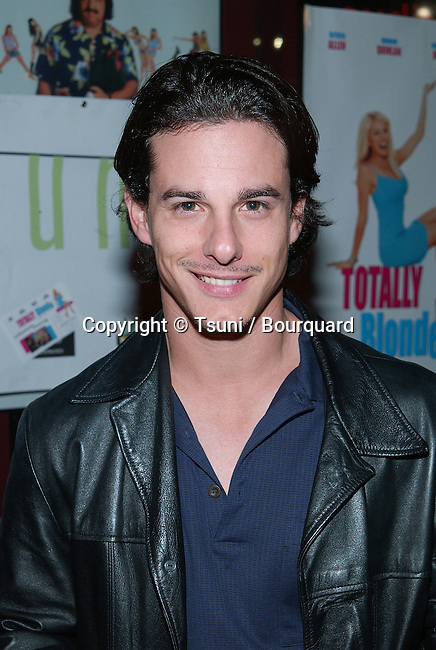 Michael Cade arriving at the premiere of Totally Blonde at the Laemmle's Sunset 5 in Los Angeles. December 17, 2001. CadeMichael01.jpg