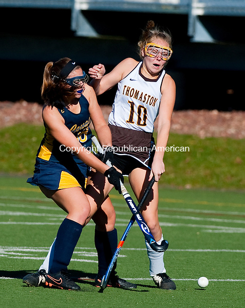 WETHERSFIELD, CT--- -112115JS03--Thomaston's Alexa Sanson (10) and Haddam-Killingworth's Cassie Harlow (38) collide while going for the ball during their Class S state finals game Saturday at Wethersfield High School.<br /> Jim Shannon Republican-American
