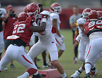NWA Democrat-Gazette/ANDY SHUPE<br /> Arkansas tight end Trey Purifoy (center) blocks linebacker Deon Edwards (22) Thursday, Aug. 9, 2018, during practice at the university's practice facility in Fayetteville. Visit nwadg.com/photos to see more photos from practice.