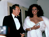 ***FILE PHOTO*** ***Vic Damone Has Passed Away aged 89***<br /> Diahann Carroll and Vic Damone in Los Angeles, California in 1986. <br /> CAP/MPI/WAL<br /> &copy;WAL/MPI/Capital Pictures