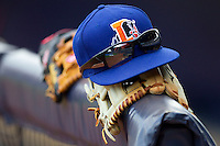 A Durham Bulls cap sits on top of a baseball glove at Durham Bulls Athletic Park June 26, 2010, in Durham, North Carolina.  Photo by Brian Westerholt / Four Seam Images