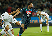 Gonzalo Higuain celebrates after scoring during the Italian Serie A soccer match between SSC Napoli and Verona  at San Paolo stadium in Naples, October 26, 2014
