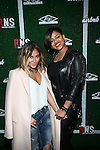 "Singers Adrienne Bailon and RaVaughn Brown Attend Airbnb & Roc Nation Sports ""Roc Nation Sports Celebration"" Held at The 40/40 Club NY"