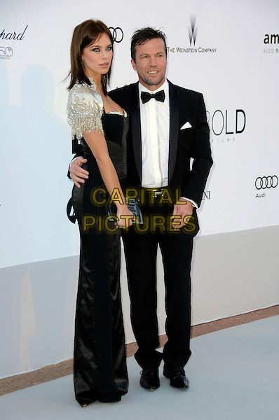 KRISTINA ILLIANA & LOTHAR MATTHAUS.arrivals at amfAR's Cinema Against AIDS 2010 benefit gala at the Hotel du Cap, Antibes, Cannes, France during the Cannes Film Festival.20th May 2010.amfar full length black dress tuxedo tux bow tie gold beaded shrug arm around side .CAP/CAS.©Bob Cass/Capital Pictures.