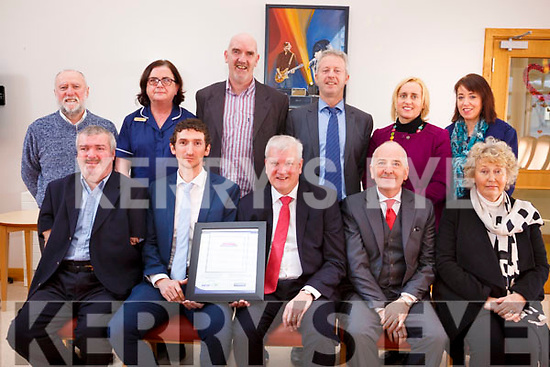 Baile Mhuire receives the Award of the Community Vibrancy Recognition Programme 2017/2019 from the NEWKD/Kerry Group acknowledging the contribution by Baile Mhuire to the Tralee community. Seated l-r, John Stack (NEWKD), Padraig Mallon (Kerry Group), Paddy Garvey (Chairperson Baile Mhuire), Aiden Kelly (Baile Mhuire) and Stella Boyle (Baile Mhuire).<br /> Standing l-r, Enda O&rsquo;Brien, Rose Daly (Nurse Manager), Ed O&rsquo;Connor (Baile Mhuire), Eamonn O&rsquo;Reilly (NEWKD), Dolores McElligott (HSC) and Carmel Walsh (Baile Mhuire).