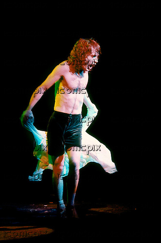 AC/DC - lead guitarist Angus Young performing live on the Back In Black Tour at the Hammersmith Odeon, London - 12 Nov 1980.   Photo credit: George Chin/IconicPix