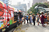 Guests lined up for food at a food truck serving South African specialties.