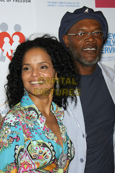 "VICTORIA ROWELL & SAMUEL L. JACKSON.Launch Party for ""The Passion Art Tour"" - Arrivals held at the Museum of Contemporary Art, Los Angeles, California, USA..May 1st, 2006.Photo: Zach Lipp/AdMedia/Capital Pictures.Ref: ZL/ADM.headshot portrait hat facial hair glasses beard.www.capitalpictures.com.sales@capitalpictures.com.© Capital Pictures."