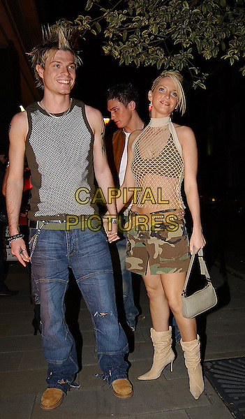 MIKEY GREEN - PHIXX, SARAH HARDING - GIRLS ALOUD.Jordan - 25th Birthday Party at Embassy Club.www.capitalpictures.com.sales@capitalpictures.com.©Capital Pictures.military, camourflage mini ksirt, mesh halterneck top, boots, belt.