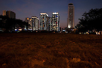 Evening Landscape View Of An Empty Lot And Commercial Building Development in Guangzhou, China.  © LAN