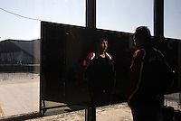 Pictured: A refugee man looks at himself in the mirror at the Elliniko camp Friday 26 February 2016<br /> Re: Refugees have been turning up at the Helliniko refugee camp in the outskirts of Athens, Greece.