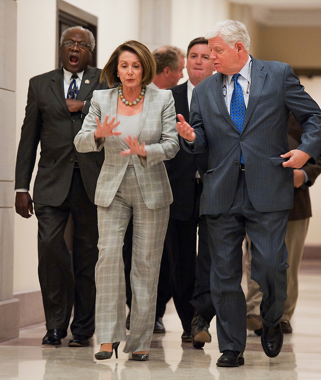 UNITED STATES - SEPTEMBER 06:  From left, Assistant Democratic Leader James Clyburn, D-S.C., House Minority Leader Nancy Pelosi, D-Calif., and Democratic Caucus Chairman John Larson, D-Conn., make their way to a news conference in the Capitol Visitor Center on job creation. (Photo By Tom Williams/Roll Call)
