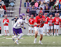 UAlbany Men's Lacrosse defeats Stony Brook on March 31 at Casey Stadium.  Ryland Rees (#17) attempting to clear the defensive end.