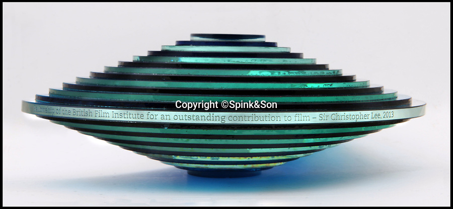 BNPS.co.uk (01202 558833)Pic: Spink&Son/BNPS<br /> <br /> Award recieved for outstanding contribution to film.<br /> <br /> Fifty medals and honours which were awarded to the legendary late actor Sir Christopher Lee have emerged for sale.<br /> <br /> During his glittering 70 year career, the acting behemoth graced our screens as Lord Summerisle in the The Wicker Man, Count Dracula in the Hammer films and Saruman in the Lord of the Rings trilogy.<br /> <br /> Other memorable roles included Scaramanga in the James Bond film The Man with the Golden Gun and Count Dooku in Star Wars. <br /> <br /> But before he found fame he served his country as a young RAF officer in the Second World War, earning mentions in despatches for gallant and distinguished service.