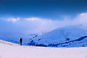 29/12/14<br /> <br /> Standing on Rushup Edge in the Peak District, a photographer watches as early morning mist lifts to reveal a snowy landscape above Edale in Derbyshire.<br /> <br /> All Rights Reserved - F Stop Press. www.fstoppress.com. Tel: +44 (0)1335 300098