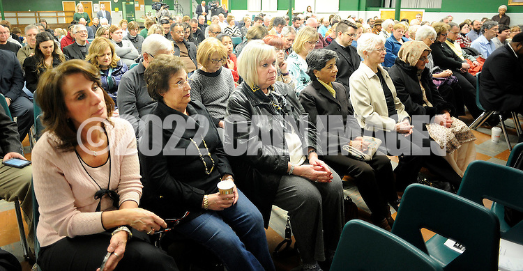 Participants listen as Assemblyman Lou Greenwald (not shown) , D-6th of Maple Shade speaks during an interfaith prayer service at Our Lady of Perpetual Health Thursday, March 2, 2017 in Maple Shade, New Jersey. (Photo by William Thomas Cain)