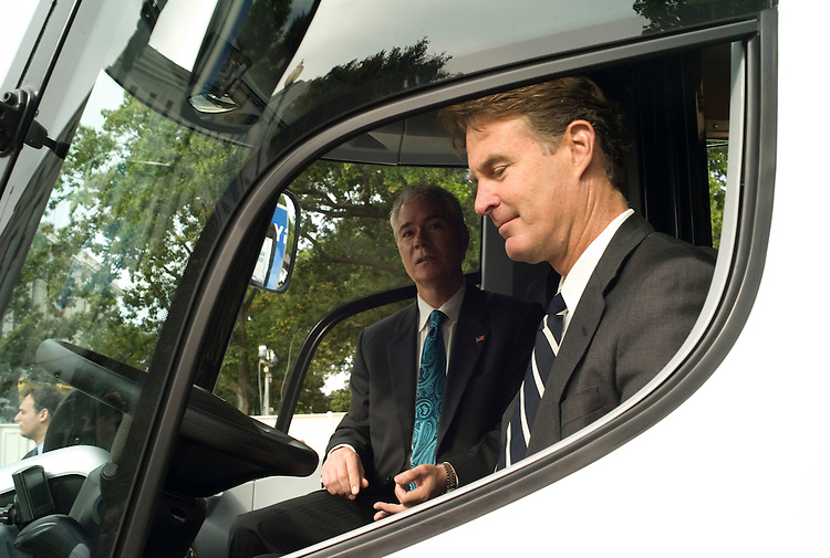 WASHINGTON, DC - Sept. 30: Sen. Evan Bayh, D-Ind., right, checks out an all-electric commercial truck from Navistar, Inc., based in Elkhart County, Ind. At left is Patrick Charbonneau of Navistar. The production of the truck was aided by federal stimulus funds, a $39 million U.S. Department of Energy grant. With the grant, Navistar intends to manufacture 400 all-electric delivery trucks in 2010, with a goal of producing several thousand vehicles annually as the market grows within the next few years. (Photo by Scott J. Ferrell/Congressional Quarterly)