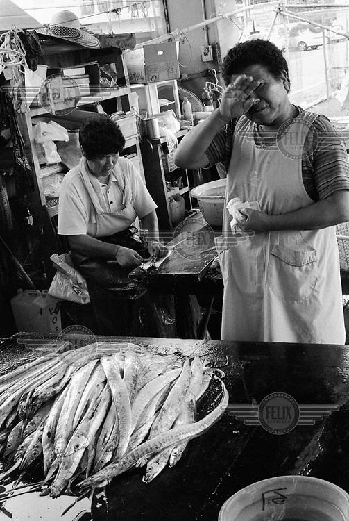 Gutting fish.