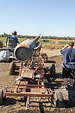 USA, Oregon, Bend, a boy shoots a pumpkin out of the cannon at the annual pumpkin patch located in Terrebone near Smith Rock State Park