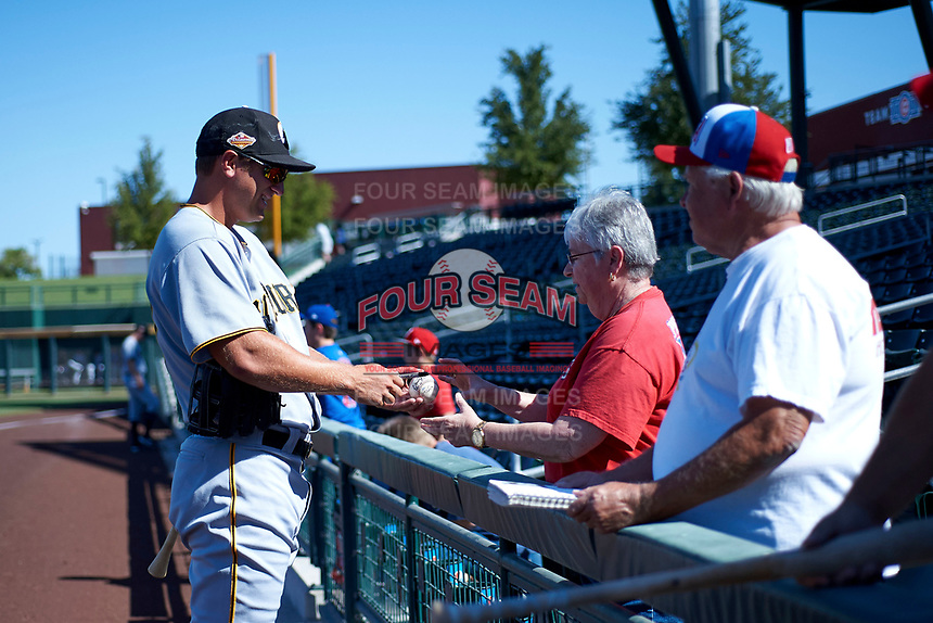 Logan Hill (37), prospect in the Pittsburgh Pirates organization and member of the Glendale Desert Dogs, signs autographs for some fans before an Arizona Fall League game against the Mesa Solar Sox on October 28, 2017 at Sloan Park in Mesa, Arizona. The Solar Sox defeated the Desert Dogs 9-6. (Zachary Lucy/Four Seam Images)