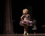 Abbygail, 3, at the stage, doing of the popular poses at The Big Trophy Pageant, Vidalia, Georgia.