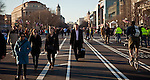 Pedestrians walk down Pennsylvania Ave in Washington DC, after it has already been closed for tomorrow's presidential inaugural parade, January 20, 2013.