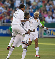 The Galaxy's Edson Buddle, center, is congratulated by teammates after scoring in the first half, San Jose Earthquakes vs Los Angeles Galaxy, Oakland, California, Saturday, June 14, 2008.
