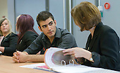 Instructor & student discuss his progress in the Arena Salon, Hair & Beauty Dept., Kingston College.