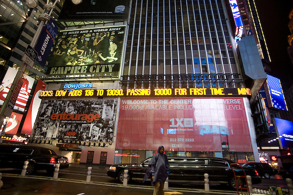 Tickers in Times Square announce that Dow industrials have jumped 136 points, rising above 13,000 for the first time.
