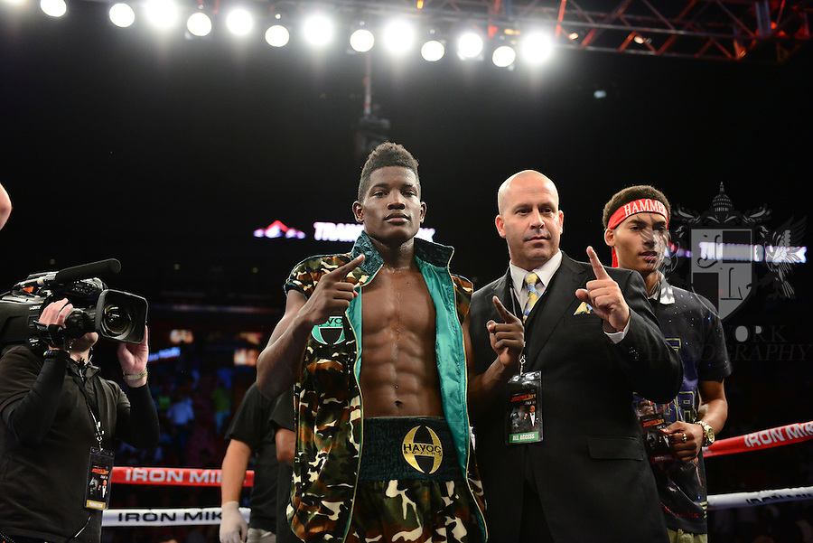 MIAMI, FL - JULY 10: Erickson Lubin (camouflage short) in the ring fighting at the Iron Mike Judgement Day boxing match at AmericanAirlines Arena on July 10, 2014 in Miami, Florida. Lubin defeated Bolanos by unanimous decision in eight rounds. (Photo by Johnny Louis/jlnphotography.com)