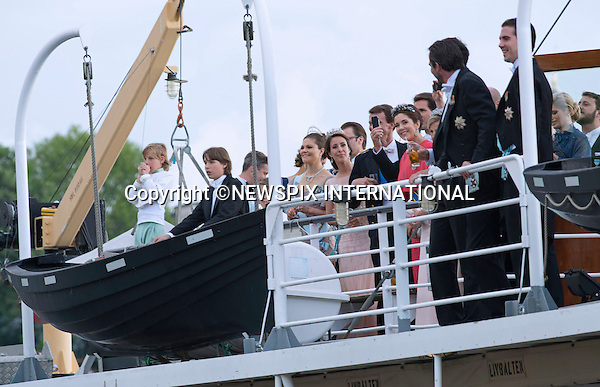 ROYAL GUESTS<br /> take a boat ride to Drottingholm Palace for the Wedding Banquet Riddarholmen, Stockholm, Sweden_08/06/2013<br /> Princess Madeleine married Christopher O'Neill at the Royal Chapel, Royal Palace in Stockholm<br /> Mandatory Credit Photo: &copy;Francis Dias/NEWSPIX INTERNATIONAL<br /> <br /> **ALL FEES PAYABLE TO: &quot;NEWSPIX INTERNATIONAL&quot;**<br /> <br /> IMMEDIATE CONFIRMATION OF USAGE REQUIRED:<br /> Newspix International, 31 Chinnery Hill, Bishop's Stortford, ENGLAND CM23 3PS<br /> Tel:+441279 324672  ; Fax: +441279656877<br /> Mobile:  07775681153<br /> e-mail: info@newspixinternational.co.uk