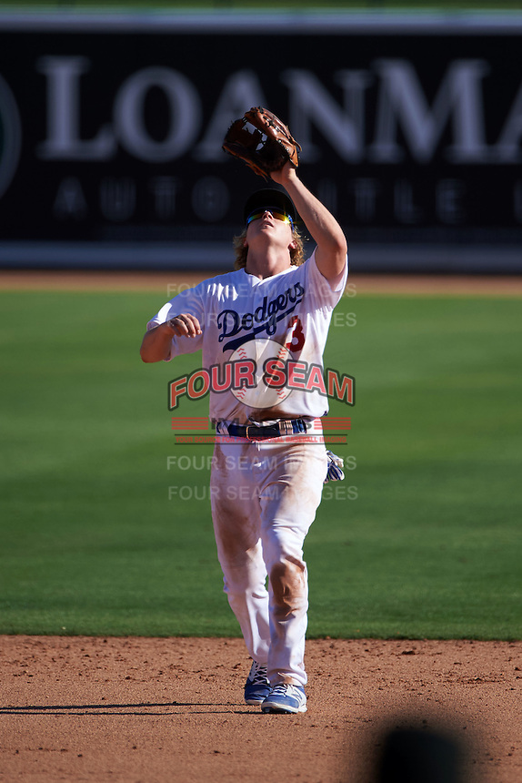Glendale Desert Dogs second baseman Brandon Dixon (3) catches a pop up during an Arizona Fall League game against the Mesa Solar Sox on October 13, 2015 at Camelback Ranch in Glendale, Arizona.  Glendale defeated Mesa 8-7.  (Mike Janes/Four Seam Images)