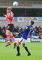 Lincoln City's Michael O'Connor heads over Crewe Alexandra's Harry Pickering<br /> <br /> Photographer Andrew Vaughan/CameraSport<br /> <br /> The EFL Sky Bet League Two - Lincoln City v Crewe Alexandra - Saturday 6th October 2018 - Sincil Bank - Lincoln<br /> <br /> World Copyright &copy; 2018 CameraSport. All rights reserved. 43 Linden Ave. Countesthorpe. Leicester. England. LE8 5PG - Tel: +44 (0) 116 277 4147 - admin@camerasport.com - www.camerasport.com
