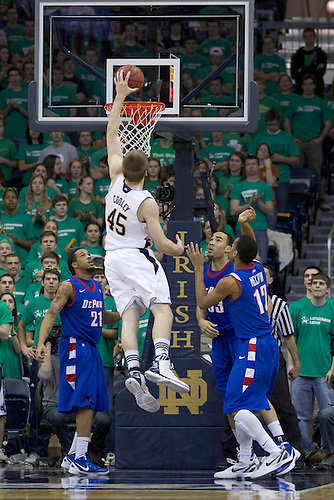 Notre Dame forward Jack Cooley (#45) goes up for a dunk in first half action of NCAA Men's basketball game between DePaul and Notre Dame.  The Notre Dame Fighting Irish defeated the DePaul Blue Demons 84-76 in game at Purcell Pavilion at the Joyce Center in South Bend, Indiana.
