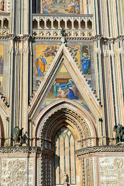 Detail of the door with mosaics depicting the life of Mary  created between 1350 and 1390 after designs by artist Cesare Nebbia on the14th century Tuscan Gothic style facade of the Cathedral of Orvieto, designed by Maitani, Umbria, Italy