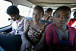 Delina Nleya (middle) sits inside a kombi--a van used as public transportation--near her home in Bulawayo, Zimbabwe. With her is her daughter Nkazimulo (right), 16. Nleya suffered a spinal cord injury and uses a wheelchair provided by the Jairos Jiri Association with support from CBM-US. People in wheelchairs in Zimbabwe are often ignored by kombi drivers, or they're charged double to bring their wheel chair along.