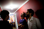From left, Eric Ruud, Jon Bafus, and Payam Bavafa of Sholi hang out at Bavafa's apartment in Oakland, CA December 21, 2008.