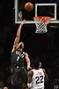 Spencer Dinwiddle #8 of the Brooklyn Nets cuts past Deandre Ayton #22 of the Phoenix Suns during an NBA game at the Barclays Center in Brooklyn, NY on Sunday, Dec. 23, 2018. Dinwiddle scored a team-high 24 points to lead the Nets to a 111-103 win.