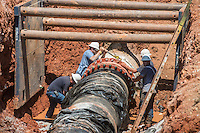 NWA Democrat-Gazette/ANTHONY REYES &bull; @NWATONYR<br /> A crew with the Fayetteville Water and Sewer department repair a 42-inch water line Friday, August 14, 2015 in a field south of Frisco Church Road in Lowell. A power outage led to the leak and shut down the line. A 36-inch water line is still supplying water but citizens in Fayetteville, West Fork, Greenland, Mount Olive, Farmington and parts of Johnson are being asked to conserve water until full service can be restored.