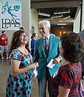 Lincoln Elementary hosts celebration to dedicate the artwork &quot;Elephant&quot; by Stefanie Gutheil. <br /> <br /> Lincoln Principal Susan French share a laugh with Henry Heuser, Jr. and Carol Ann Haddad.